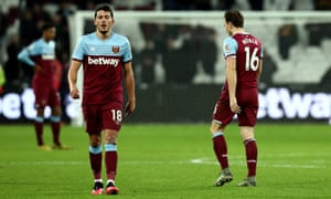 Pablo Fornals and Mark Noble look dejected after the home defeat to Liverpool in January