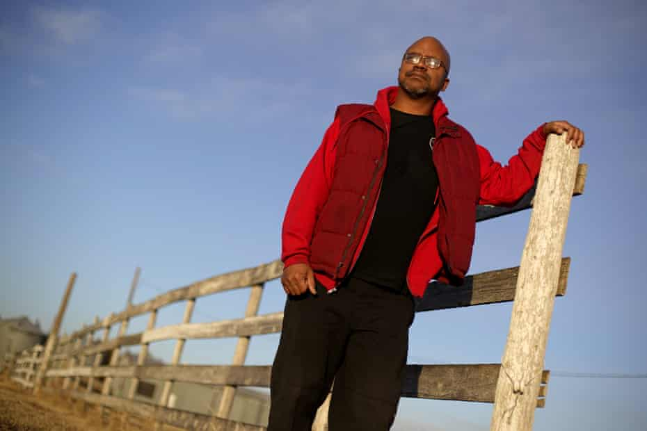 Lateef Dowdell stands on land once belonging to his uncle Gil Alexander, who was the last active Black farmer in the community of Nicodemus, Kansas. There are fewer than 50,000 Black farmers today.