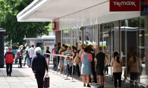 Shoppers queue outside TK Maxx in Plymouth.