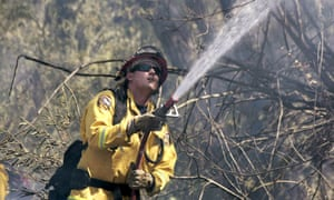 A firefighter works the front lines of the Tassajara wildfire on Sunday in Carmel Valley, California.