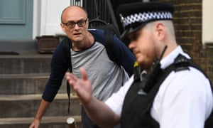 Dominic Cummings and a police officer pointing to 10 Downing Street