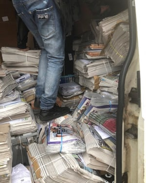 Newspapers are delivered to Guy Wright's shop.