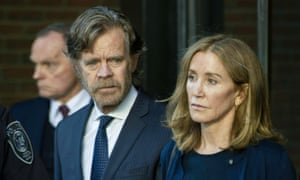 Felicity Huffman exits a courthouse in Boston, Massachusetts, with her husband, William H Macy, on 13 September.