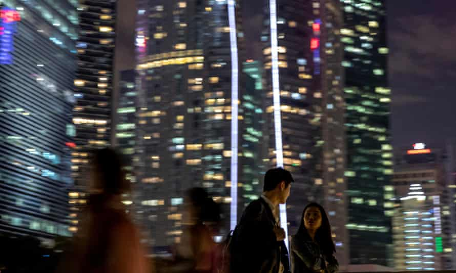 A couple in front of tower blocks in Singapore