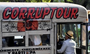 A man boards the 'Corruptour', a bus that offers a sightseeing tour through parts of Mexico City related to recent corruption scandals that have embroiled the country's top party.
