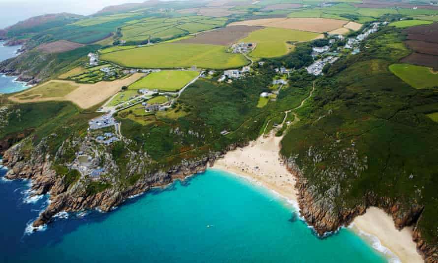 Aeriel view of the cliffs and coastline of Cornwall, including the Minack theatre.