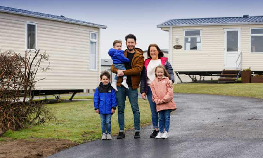 Jonathan and Lauren Moran pose with their three children at a holiday park in Pembrokeshire, Wales