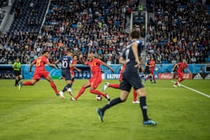 France's Kylian Mbappé (second from left) takes on Moussa Dembélé (left) and Vincent Kompany of Belgium during the semi-final at the St Petersburg Stadium.