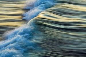 Wave reflects sun