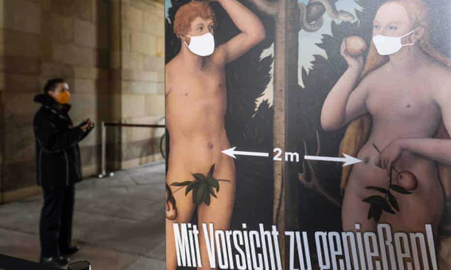 A poster showing Adam and Eve wearing masks and social distancing at the entrance to the Zwinger palace complex in Dresden.