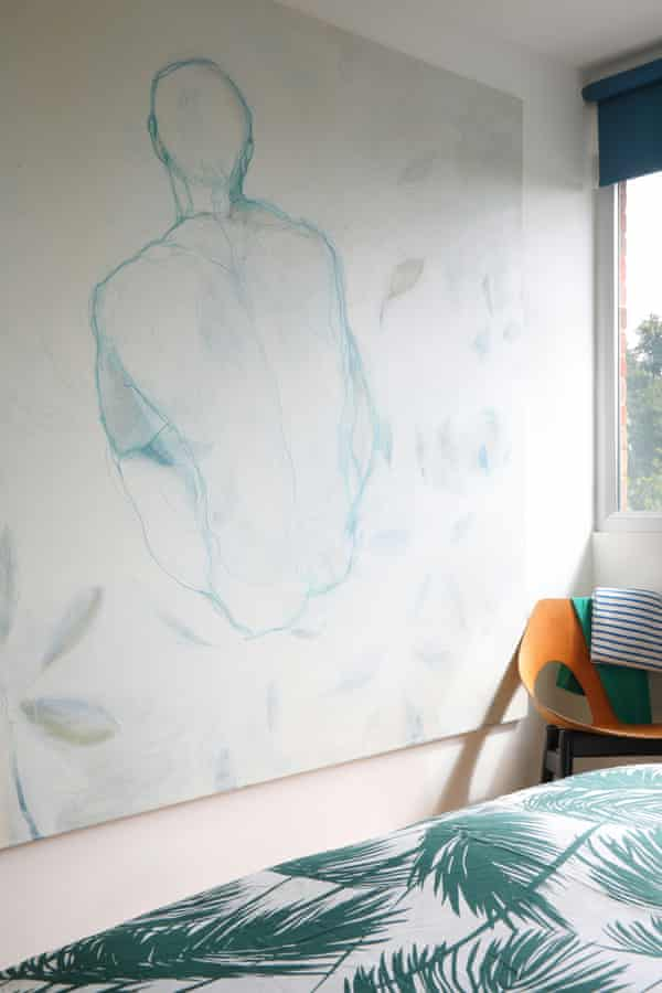 A bedroom with artwork by Curtis on the wall.