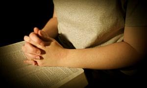 Woman Praying over Bible