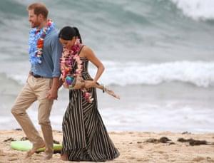 Prince Harry and Meghan: barefoot on Bondi beach.
