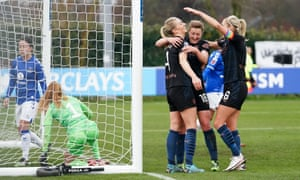 Gemma Bonner of Manchester City celebrates with teammates after scoring.
