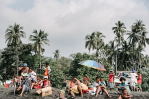 Residents from nearby villages gather with their belongings on beach near Lone, West Ambae awaiting evacuation to Santo.