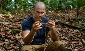 Ed Stafford, makes a snare using local bushcraft in a mangrove forest in Sepilok Laut Borneo, Malaysia