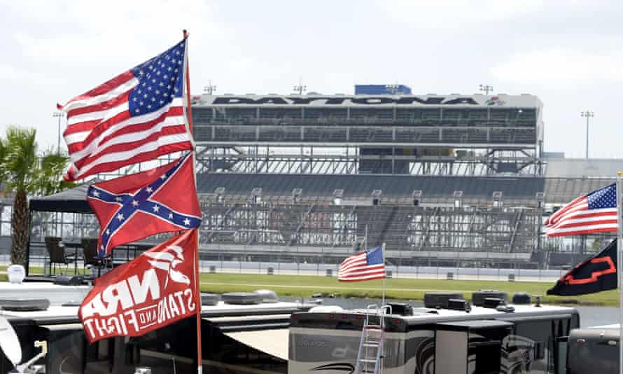 American, Confederate and NRA flags fly on top of motor homes at the Daytona International Speedway in July 2015.