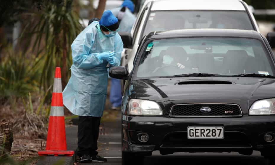 A nurse performs a Covid-19 test at Eden Park in Auckland, New Zealand.