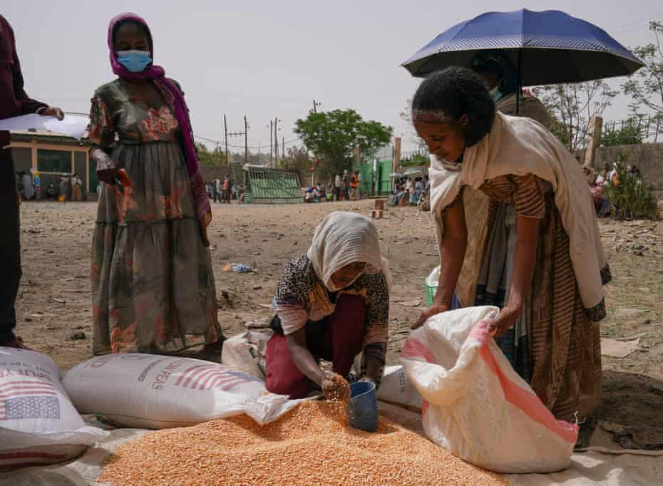 An aid worker distributes lentils in Mek'ele, the capital of Tigray.