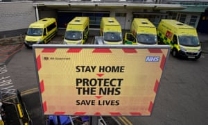 An electronic sign gives out coronavirus pandemic information to visitors and staff outside the Royal Liverpool university hospital.