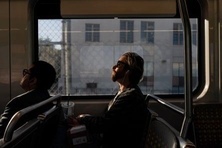 Zaq rides the Metro to campus to study and do homework.