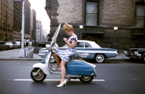 "New York City, 1965 by Joel Meyerowitz/Aperture""A girl on a Vespa on her way to 'who knows where,' when the light stopped her at the 72nd street crossing near the Dakota, where John Lennon would one day cross paths with his fate. She takes this moment to finesse a fingernail before she resumes her downtown journey, while I, stopping at the same crossing, but on foot, leap into the street to capture this vision of a dream girl before time takes her on her way."""