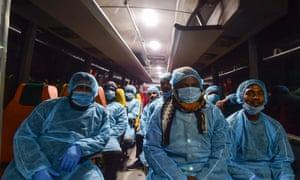 A bus transports Bangladeshi nationals evacuated from the Chinese city of Wuhan to a quarantine centre in Dhaka on Saturday.