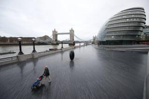 The empty riverside walk next to Tower Bridge