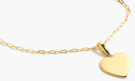 a gold necklace with a gold heart pendant
