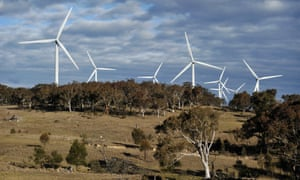 Infigen Energy's Capital Wind Farm Wind turbines stand behind trees at the Capital Wind Farm, operated by Infigen Energy, in Bungendore, New South Wales, Australia