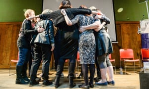 Women's Equality party members in a group hug