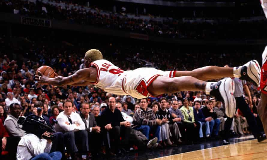 Dennis Rodman of the Chicago Bulls goes fully horizontal as he dives for a loose ball.