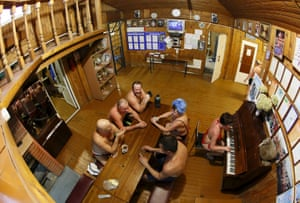 The cryophile winter swimmers club has about 300 members with ages ranging from just one-year to over 80-years old. The wooden clubhouse on the banks of the Yenisei river provides a warm place for the members to meet and share their love of bracing, cold water
