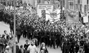 Police officers escort a National Front rally through Lewisham on 13 August 1977.