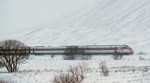 Drumochter Pass, Scotland. The LNER Inverness to London train makes its way through snow