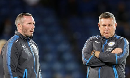 Leicester City's former manager Craig Shakespeare, right, talks with his assistant Michael Appleton, the new caretaker, before Monday's Premier League draw with West Bromwich.