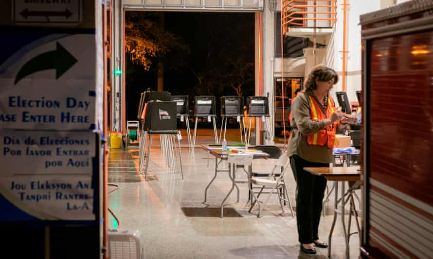 An election worker at Coral Gables in Florida on Tuesday. There was low in-person turnout in Florida and Illinois.