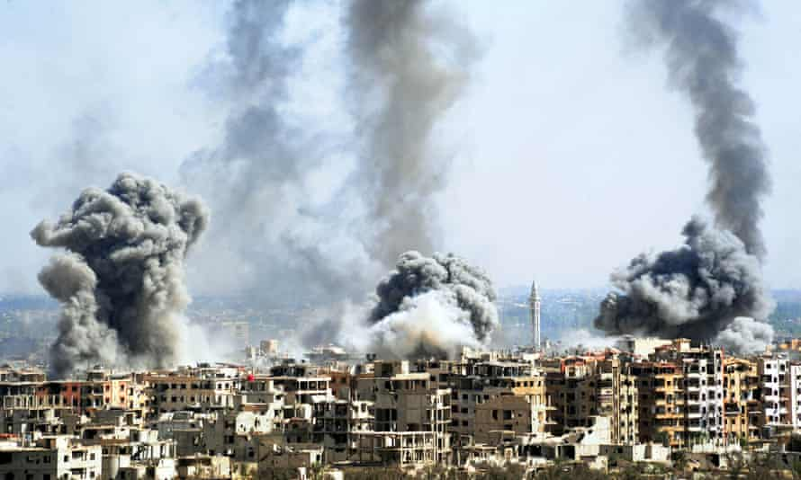 Smoke rises after Syrian army shelling of Douma, eastern Ghouta, 7 April.