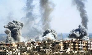 Smoke rises from shelled buildings in Douma