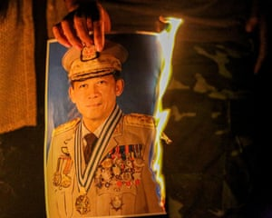 A portrait of army commander-in-chief Min Aung Hlaing is burned in Mandalay