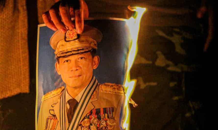 Protester burning a portrait of the army chief Min Aung Hlaing
