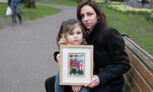Kelly McDermott and her daughter Sophia with a picture of Christos Uta Pailodze