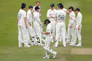 Tom Latham walks after losing his wicket.