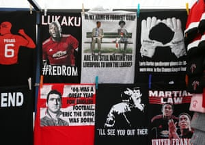 A merchandise stall selling a t-shirt regarding the last time Liverpool won the league.