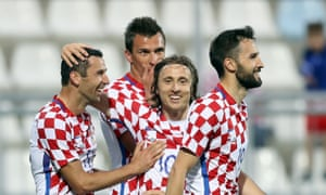 From left: Croatia's Dario Srna, Mario Mandzukic, Luka Modric and Milan Badelj celebrate scoring their team's third goal against San Marino on June 4.