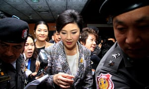 Yingluck Shinawatra leaves the final impeachment hearing at Parliament in Bangkok. The former prime minister now faces a court trial over a rice subsidy scheme.
