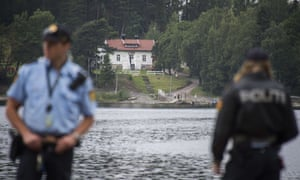 out of focus Norwegian police officers on Utøya waterfront, Norway