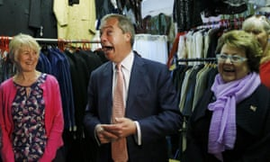 Ukip leader Nigel Farage talks with supporters at a small business in Canterbury.