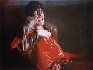 Heartbreak in red … the family tragedy.