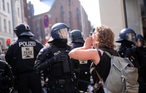 A woman shouts in the face of a police officer